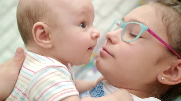Thumbnail for Happy Sister Kissing Baby Brother Close Up of Girl Kiss Cute Baby Boy
