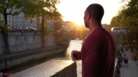 Thumbnail for African-American male traveling in Paris watches beautiful sunset