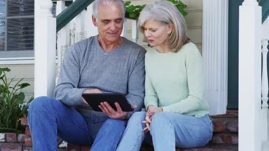 Thumbnail for Senior couple using tablet outside