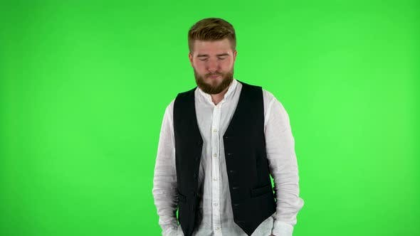 Thumbnail for Man Is Offended and Looks Away, Then Smiles. Green Screen