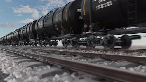 Cistern Petroleum Train with Crude Oil Moving Fast on Railroad
