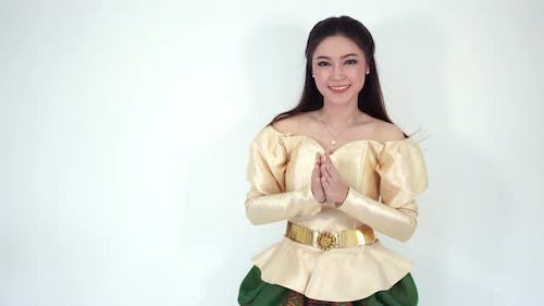 happy beautiful woman in Thai traditional dress is pay respect