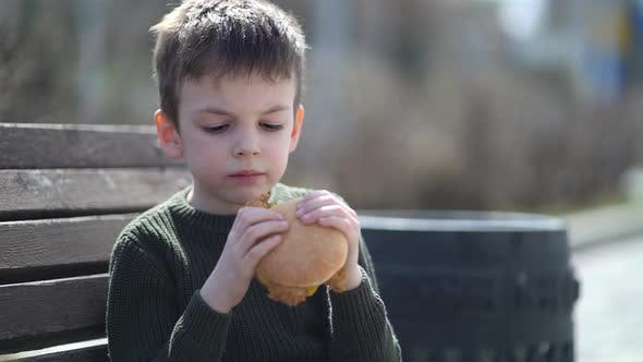 Hungry Kid Eating Burger Outdoor
