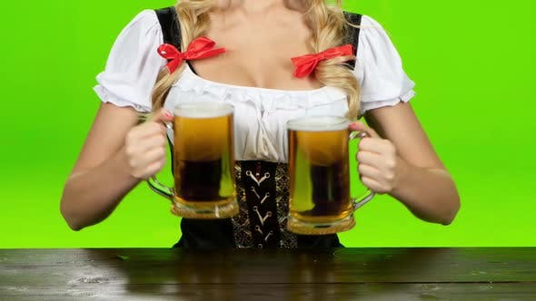 Thumbnail for Girl in Bavarian Costume Puts the Glasses with Beer. Green Screen. Close Up