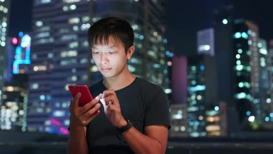 Cover Image for Man use of mobile phone in city of Hong Kong