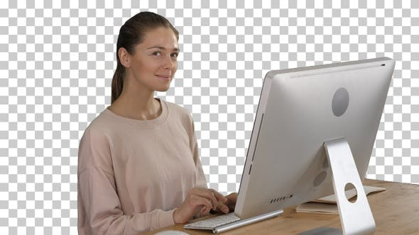 Thumbnail for Blonde woman using computer and having an idea smiling