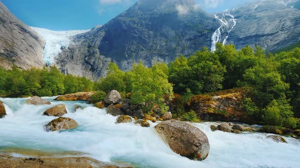 Thumbnail for The Nature of Norway Is a Turbulent River From the Melted Waters of the Briksdal Glacier