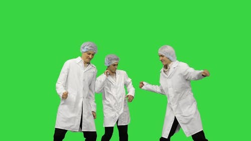 Three Male Doctors in White Robes and Protective Caps Running in the Frame and Start Dancing in a