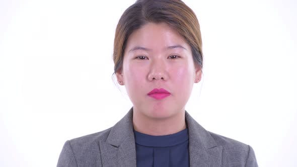 Thumbnail for Face of Happy Young Asian Businesswoman Talking