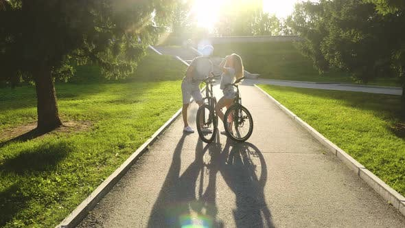 Thumbnail for Family Couple Walking with Bicycle