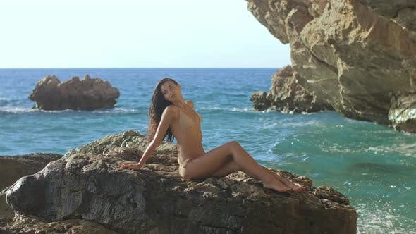 Thumbnail for Portrait of Beautiful Young Woman on Wild Rocky Beach.