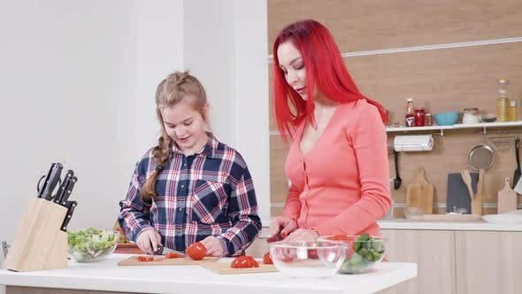 Redhead Mother Bonding with Her Daughter at the Kitchen
