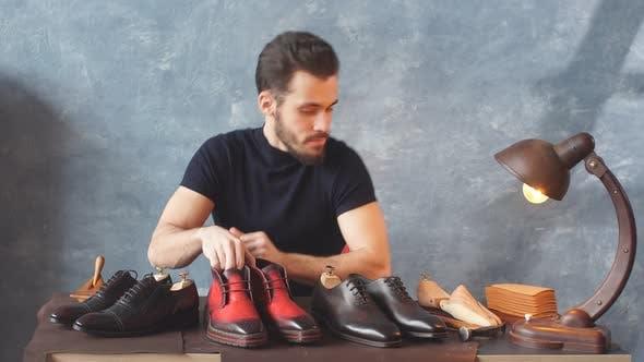 Handsome Shoe Designer Looking at Camera, French Footwear Designer at Work