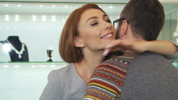 Thumbnail for Happy Woman Smiling Embracing Her Man After Shopping at the Jewelry Store