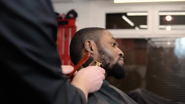 The Hairdresser Trims the Beard with a Typewriter