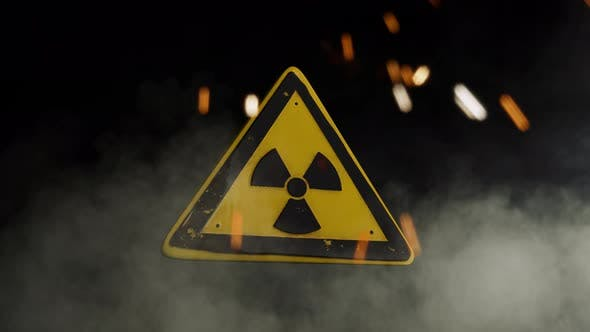 Ionizing Radiation Sign Over a Smoky Background