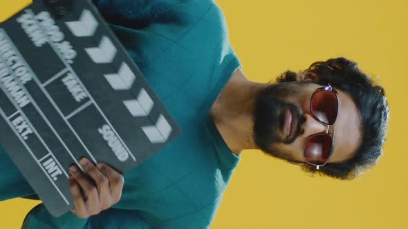 Thumbnail for Bored Man Clapping Clapperboard