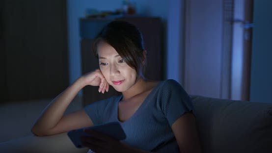 Thumbnail for Woman look at  mobile phone at night