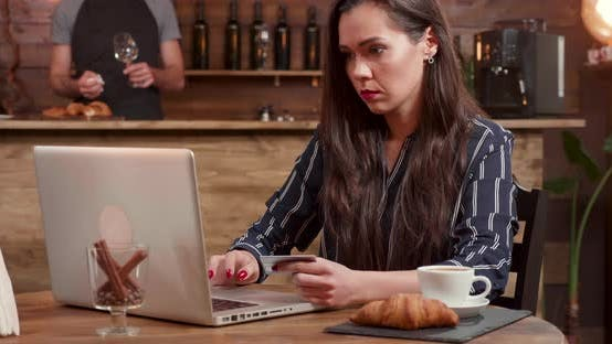 Thumbnail for Beautiful Woman Introducing Her Card Number in a Laptop While Shopping Online