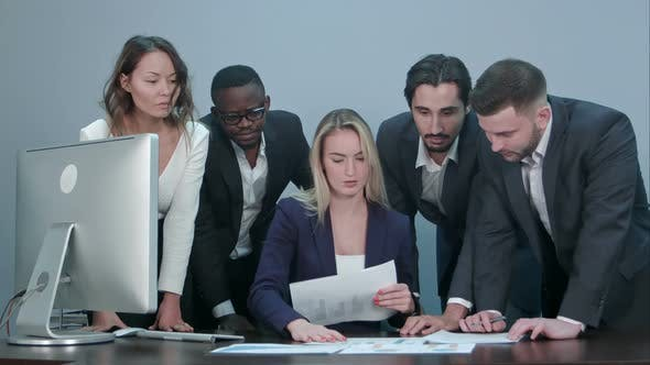 Thumbnail for Group of Business People Busy Discussing Financial Matter During Meeting
