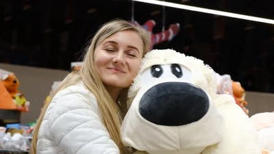 Blonde with a Big Soft Toy