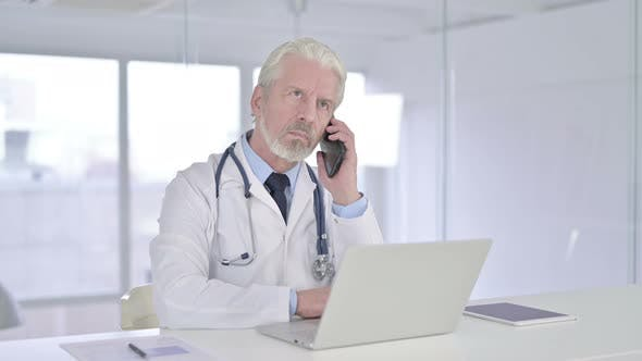 Thumbnail for Happy Old Senior Doctor Talking on Smartphone