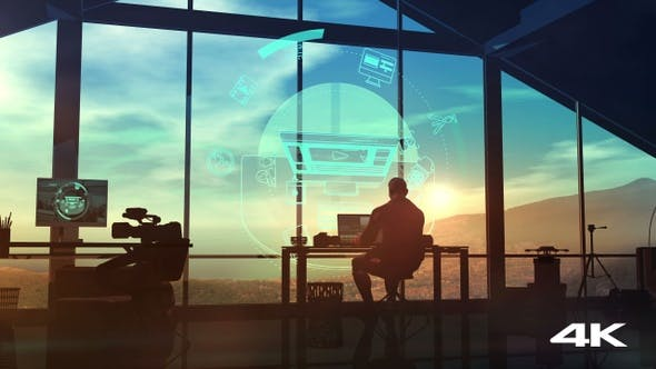 Thumbnail for The silhouette of a videographer at a workplace in his office 4K