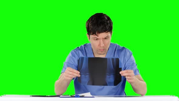 Thumbnail for Doctor Examines an X-ray Knees. Green Screen
