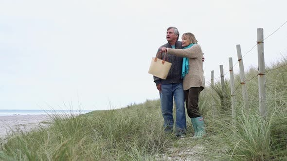 Thumbnail for Couple Standing on Dune at The Coast