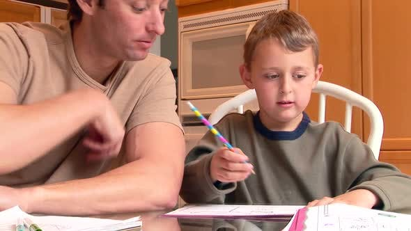 Thumbnail for Portrait of father helping son with homework
