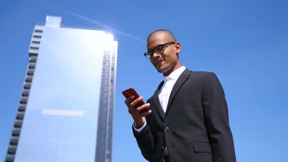 Thumbnail for Businessman Using Mobile Phone Outdoors. Business And Technology Concept