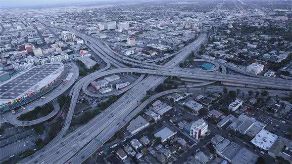 Thumbnail for The Highway intersection at dusk as seen from a helicopter