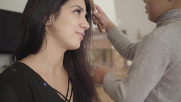 Thumbnail for Close-up of Middle Eastern Boy Combing the Smiling Woman with Long Dark Hair and Hazel Eyes