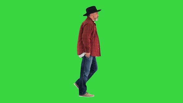 Senior Farmer with Hat Walking on a Green Screen Chroma Key