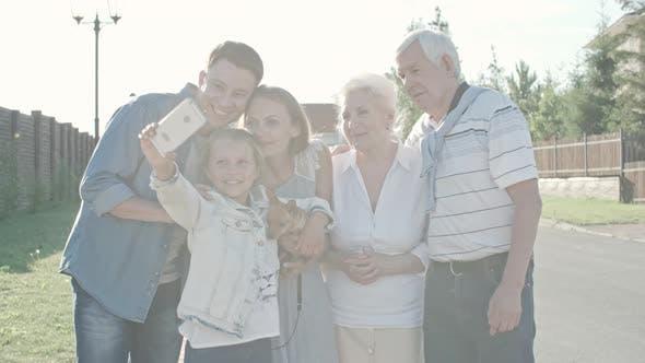 Thumbnail for Little Girl Taking Selfie of Family