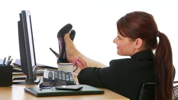 Thumbnail for Businesswoman with feet up on desk
