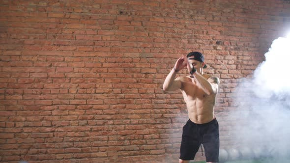 Thumbnail for Muscular Male Practicing Plyometric Exercise on Jump Box in Dark Gym