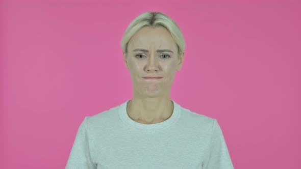 Thumbnail for Sad Young Woman Isolated on Pink Background