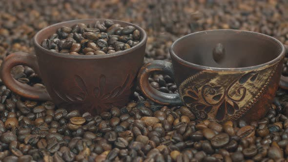 Thumbnail for Coffee Beans Are Poured Into Beautiful Cups