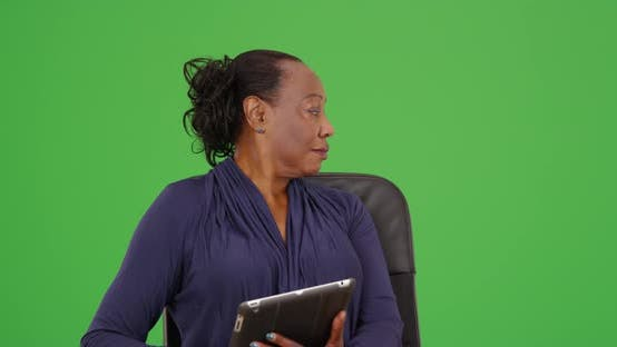 Thumbnail for An African American businesswoman holding a tablet on green screen
