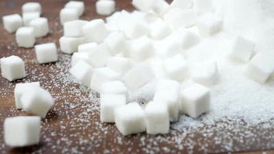 Sugar and Refined Sugar on Wooden Background