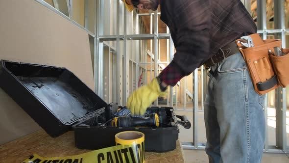 Caucasian Construction Worker Preparing His Tools For the Job