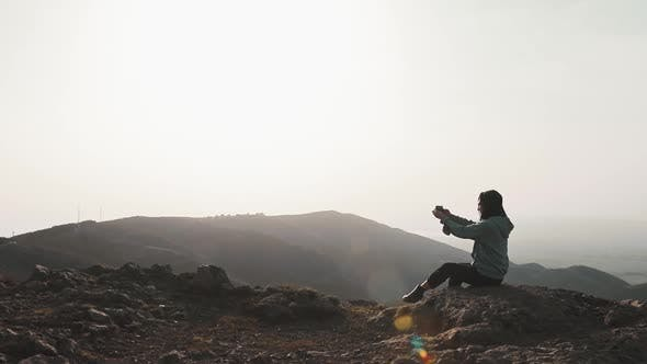 Girl With Smartphone Taking Photographs In Mountains