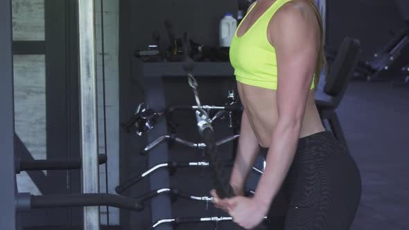 Thumbnail for Sexy Sportswoman with Perfect Body Doing Rope Pull Down Exercise