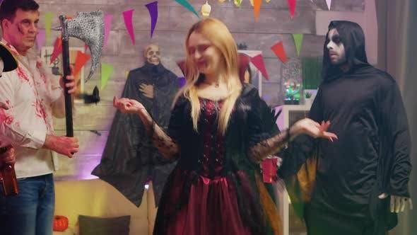Thumbnail for Evil Beautiful Enchantress Dancing at Halloween Party