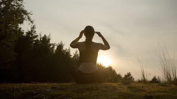 Girl Meditates on the Horizon with Sunset