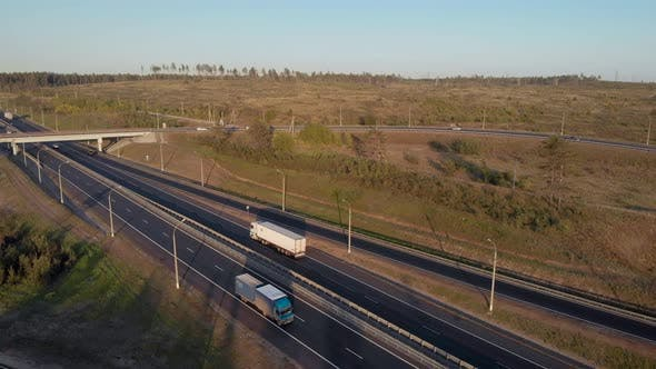 Aerial View. Interchange on the Intercity Highway. Cars and Trucks Travel in Different Directions