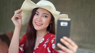 woman making selfie photo on smartphone