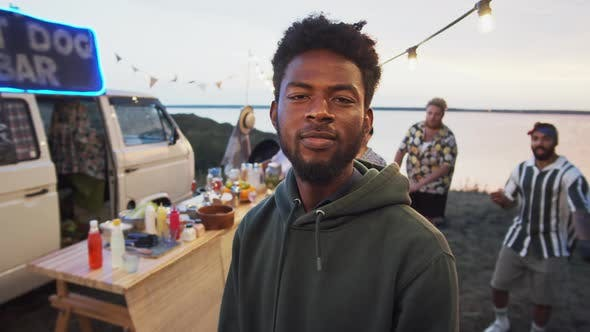 Portrait of Positive Afro Man on Summer Festival