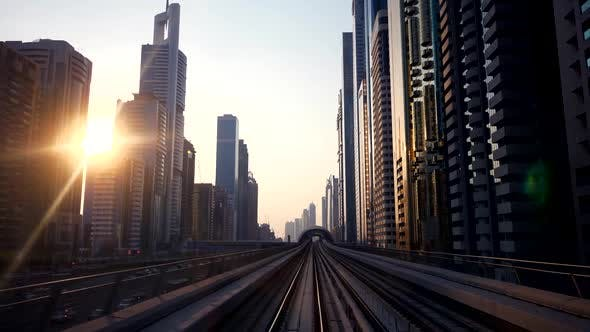 Thumbnail for Metro Railway Train Track Moving between Cityscape Skyline Buildings